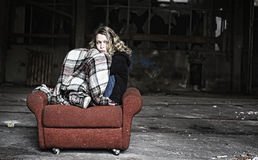 Sad girl in shabby sofa Royalty Free Stock Photo
