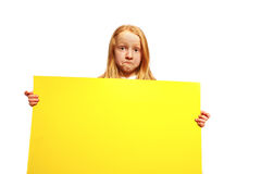 Sad girl with shield. Sad young girl with yellow shield stock photo