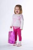 Sad girl with shopping bag Royalty Free Stock Photos