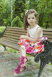 Sad girl sits in park on a bench Royalty Free Stock Images