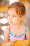 Sad girl sits at table Royalty Free Stock Photos