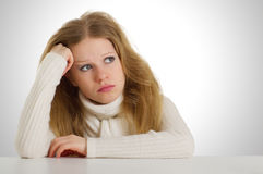Sad girl sitting. Shaggy head on his hand propping up stock images