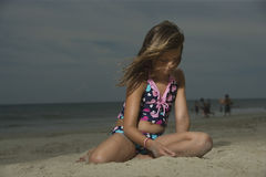 Sad Girl Sitting On Beach Stock Image