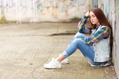 Sad girl sitting Stock Images