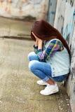 Sad girl sitting Royalty Free Stock Photo