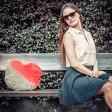 Sad girl sitting on bench. Royalty Free Stock Photos