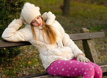 Sad girl sitting on the bench Royalty Free Stock Photography