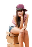 Sad girl sitting on cardboard boxes Stock Photo