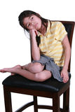 Sad girl sitting on chair Royalty Free Stock Image