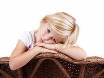 Sad girl sitting in chair Stock Photos