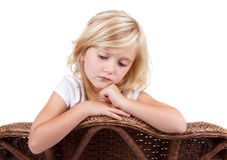 Sad girl sitting in chair Stock Images