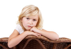 Sad girl sitting in chair Royalty Free Stock Photo