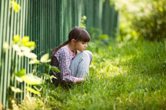 Sad girl sitting on the grass Royalty Free Stock Image