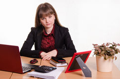 Sad girl sitting at office desk Royalty Free Stock Photography