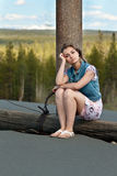 Sad Girl Sitting On A Log Royalty Free Stock Photography