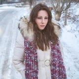 Sad girl in snow. Sad girl walking in snow Royalty Free Stock Photo
