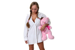 Sad girl with soft toy. Royalty Free Stock Image