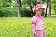 Sad girl in spring park. Portrait of a sad cute little girl in spring park Stock Photo