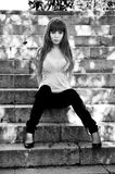 Sad girl on stairs in black and white Royalty Free Stock Photos