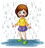 Sad girl standing in the rain Royalty Free Stock Images