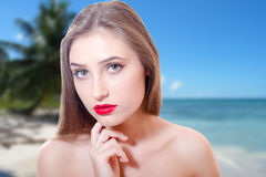 Sad girl staying on beach daydreaming Royalty Free Stock Photography