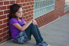 Sad girl on street Royalty Free Stock Photos