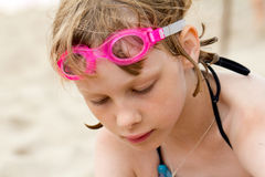 Sad girl in swimming goggles at the beach Royalty Free Stock Photography