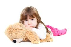 Sad girl with teddy bear Royalty Free Stock Photo