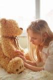 Sad girl with teddy bear Stock Photo