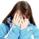 Sad Girl. Sad Teenage Girl crying Isolated on the White Background Stock Photo