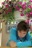 Sad girl in the terrace Stock Photo