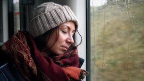 Sad girl tourist sleep near the train window. Fast train stock video footage