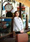 Sad girl tourist with suitcase   Stock Photo