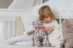 Sad girl with toy bear. Royalty Free Stock Images
