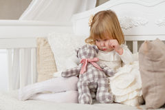 Sad girl with toy bear. Stock Photo