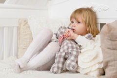 Sad girl with toy bear. Royalty Free Stock Image