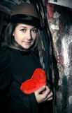 Sad girl with toy heart Royalty Free Stock Photography