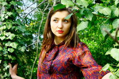 Sad girl and trees. Royalty Free Stock Photography