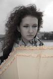 Sad girl with umbrella royalty free stock photography