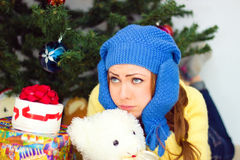Sad girl  is under the Christmas tree Stock Photo