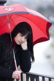 Sad girl under rain Stock Images