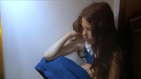 Sad girl upset embraces her feet. is depressed and suicidal little lamentable girl schoolgirl sadness misses the night. In bed concept childhood family. the stock footage