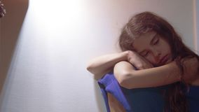 Sad girl upset embraces her feet. is depressed and suicidal little lamentable girl schoolgirl sadness misses the night. In bed concept childhood family. problem stock video footage