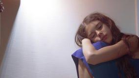 Sad girl upset embraces her feet. is depressed and suicidal little lamentable girl schoolgirl sadness misses the night. Sad girl upset embraces her feet. is stock video