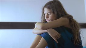 Sad girl upset embraces violence her feet. is depressed and suicidal little lamentable girl schoolgirl sadness misses. The night in bed concept lifestyle stock video footage