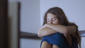 Sad girl upset embraces violence her feet. is depressed and suicidal little lamentable girl schoolgirl sadness misses. The night lifestyle in bed concept stock video footage