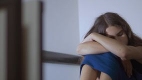 Sad girl upset embraces violence her feet. is depressed and suicidal little lamentable girl schoolgirl sadness misses. Lifestyle the night in bed concept stock footage