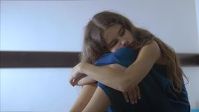 Sad girl upset embraces violence her feet. is depressed and suicidal little lamentable girl schoolgirl sadness misses. The night in bed lifestyle concept stock video footage
