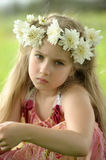 Sad girl with a wreath of flowers Stock Photography