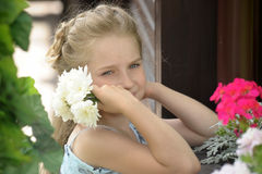 Sad girl with a wreath of flowers Royalty Free Stock Photos